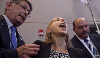 CODEPINK founder Medea Benjamin shouts at President Obama as she is removed from the back of the auditorium during his speech about national security on May 23, 2013, at the National Defense University at Fort McNair in Washington. (Associated Press)