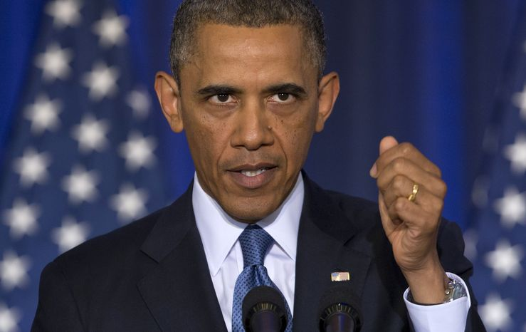 President Obama speaks about national security on May 23, 2013, at the National Defense University at Fort McNair in Washington as CODEPINK founder Medea Benjamin shouted at him from the back of the auditorium. (Associated Press)