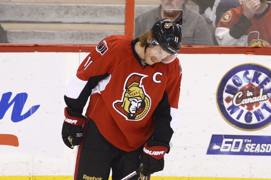 Ottawa Senators' Daniel Alfredsson reacts after missing a scoring opportunity against the Pittsburgh Penguins during second-period NHL hockey playoff game action in Ottawa, Ontario, Wednesday, May 22, 2013. (AP Photo/The Canadian Press, Adrian Wyld)