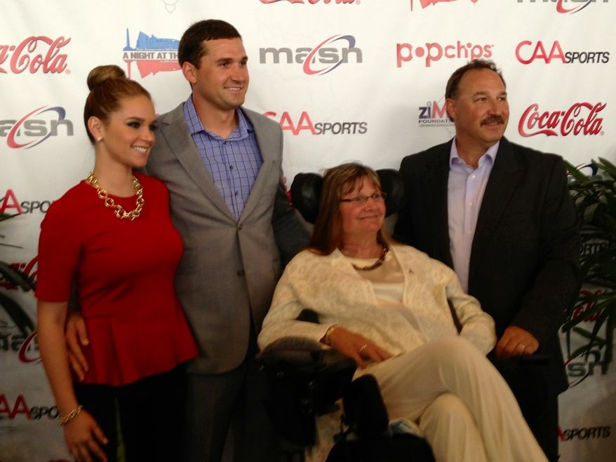 "Nationals third baseman Ryan Zimmerman, second from left, along with his wife Heather, left, and parents Cheryl and Keith, posed at the start of Zimmerman's annual ""A Night at the Park"" fundraiser at Nationals Park on Thursday. Cheryl Zimmerman has Multiple Sclerosis and Ryan Zimmerman's ziMS Foundation works to raise money to help find a cure for this disease. (Staff photo)"