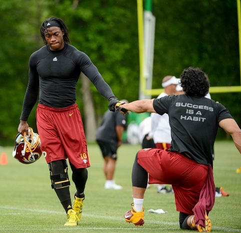 Washington Redskins quarterback Robert Griffin III works out with his team during organized team activities at Redskins Park, Ashburn, Va., Thursday, May 23, 2013. (Andrew Harnik/The Washington Times)