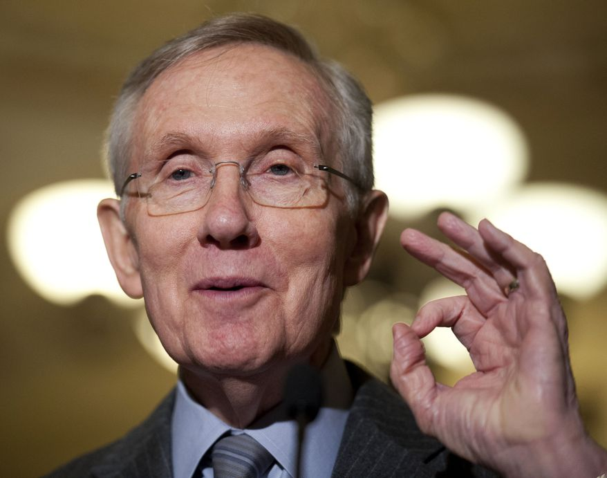 **FILE** Senate Majority Leader Harry Reid, Nevada Democrat, speaks with reporters as he leaves the weekly Democratic Caucus Lunch on Capitol Hill in Washington on May 14, 2013. (Associated Press)