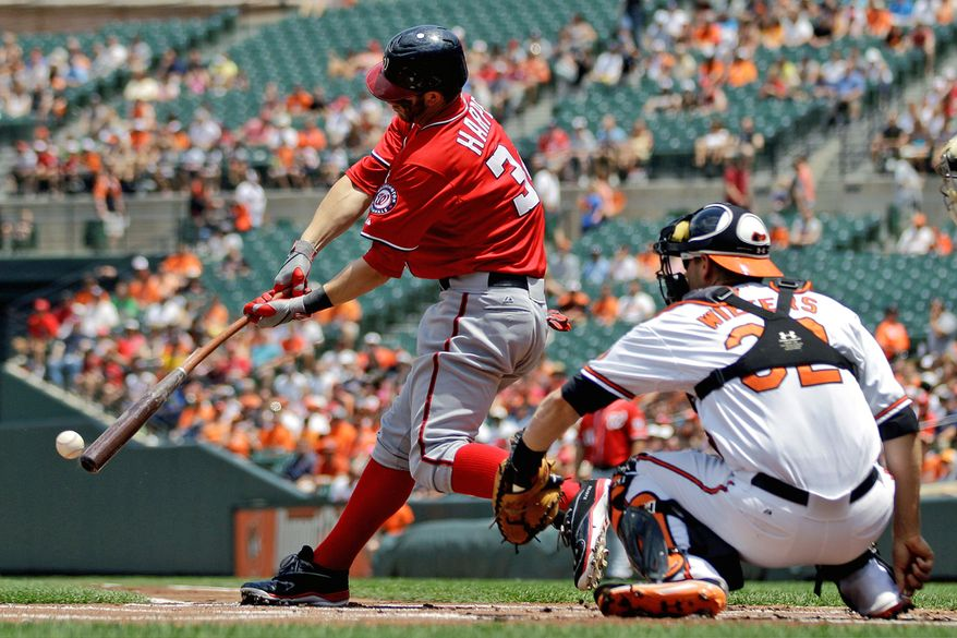 Washington Nationals' Bryce Harper singles in the first inning of an interleague baseball game against the Baltimore Orioles