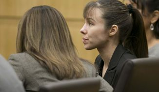 Jodi Arias listens as the verdict for sentencing is read for her first-degree murder conviction at Maricopa County Superior Court in Phoenix, Ariz., on Thursday, May 23, 2013. The jury in Jodi Arias' trial was dismissed Thursday after failing to reach a unanimous decision on whether the woman they convicted of murdering her one-time boyfriend should be sentenced to life or death in a case that has captured headlines worldwide with its sex, lies, violence. (AP Photo/The Arizona Republic, David Wallace, Pool)