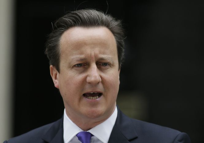 Britain's Prime Minister David Cameron speaking to the media outside 10 Downing St. in London, Thursday, May 23, 2013. (AP Photo/Alastair Grant) ** FILE **