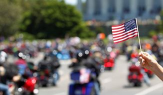 "Motorcyclists ride across Memorial Bridge into Washington during the Rolling Thunder ""Ride for Freedom"" parade Sunday. (Associated Press)"