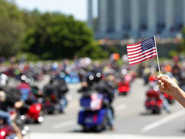 """Motorcyclists ride across Memorial Bridge into Washington during the Rolling Thunder """"Ride for Freedom"""" parade Sunday. (Associated Press)"""