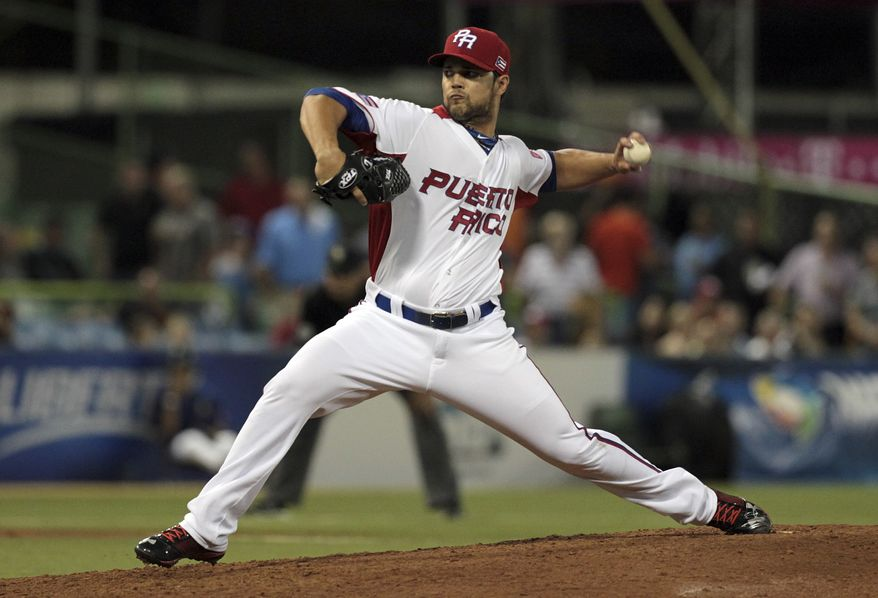 Puerto Rico closing pitcher Xavier Cedeno throws in the 9th inning in the World Baseball Classic first round game against Spain in San Juan, Puerto Rico, Friday, March 8, 2013. Puerto Rico won 3-0. (AP Photo/Dennis M. Rivera Pichardo)