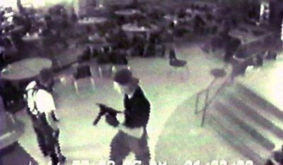 ** FILE ** Eric Harris (left) and Dylan Klebold, carrying a TEC-9 semi-automatic pistol, are seen in a photo made from a security camera image in the cafeteria at Columbine High School in Littleton, Colo., during their shooting rampage on April 20, 1999. (AP Photo/Jefferson County Sheriff's Department)