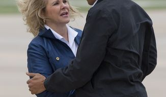 Oklahoma Gov. Mary Fallin greets President Obama as he arrives on Sunday, May 26, 2013, at Tinker Air Force Base in Midwest City, Okla., en route to Moore, Okla., to see the response efforts to the severe tornadoes and weather that devastated the area. He also will visit with the families affected as well as first responders. (AP Photo/Carolyn Kaster)