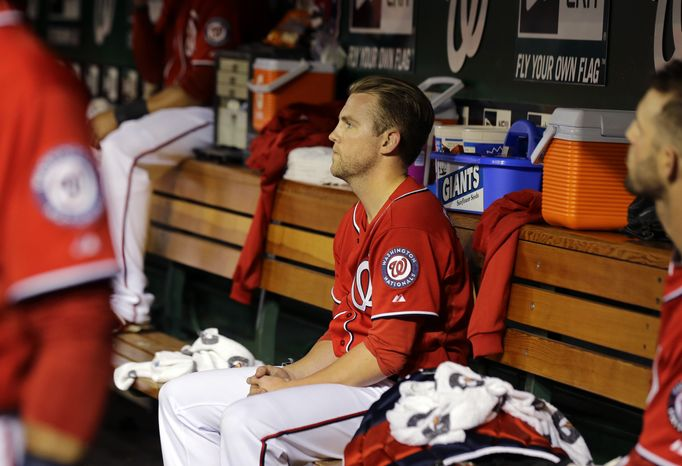 Washington Nationals relief pitcher Drew Storen (22) sits in the dugout after the eighth inning of a baseball game against the Philadelphia Phillies at Nationals Park, Saturday, May 25, 2013, in Washington. Storen gave up two runs. The Phillies won 5-3. (AP Photo/Alex Brandon)