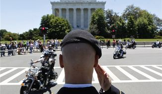 "Motorcycles participate in the annual Rolling Thunder ""Ride for Freedom"" parade ahead of Memorial Day in Washington, Sunday, May 26, 2013. (AP Photo/Molly Riley)"