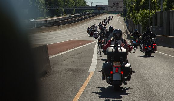 Fairfax VA Chapter, Harley Owners Group, ride down the entrance ramp onto Interstate 66 during the annual Ride of the Patriots, in support of Rolling Thunder, in Fairfax, VA., Sunday, May 26, 2013.  (Andrew S Geraci/The Washington Times)