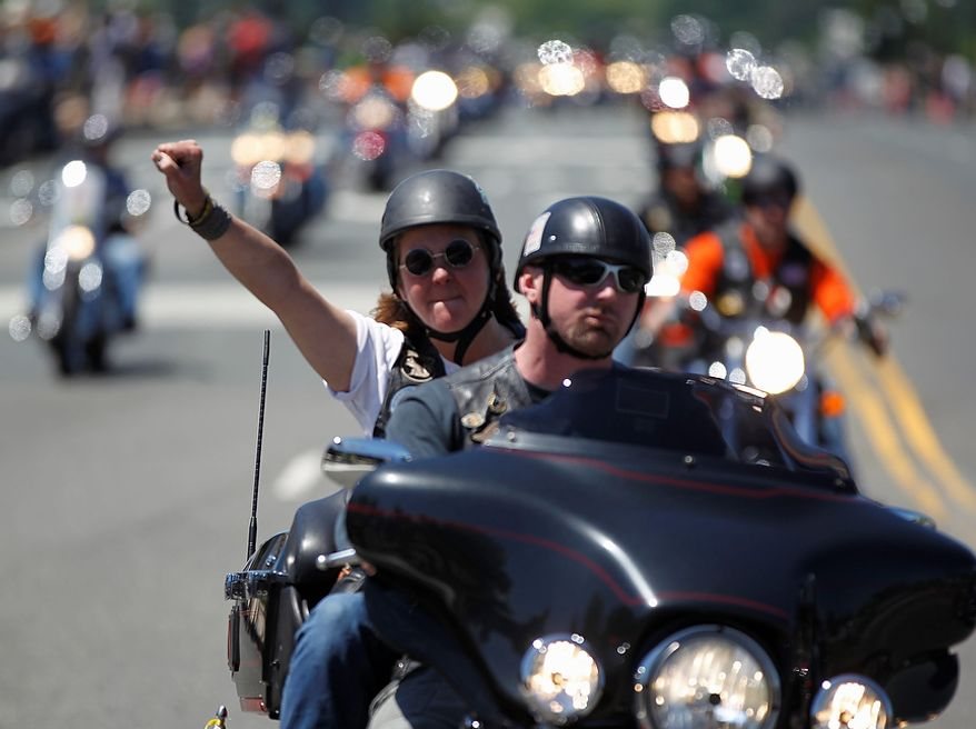 """Motorcyclists right across the Memorial Bridge into Washington Sunday, May 26, 2013, during the annual Rolling Thunder """"Ride for Freedom"""" parade ahead of Memorial Day. (AP Photo/Molly Riley)"""