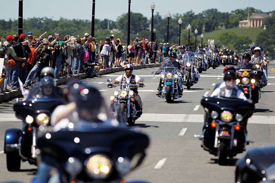 """Motorcyclists ride across Memorial Bridge into Washington during the annual Rolling Thunder """"Ride for Freedom"""" parade ahead of Memorial Day Sunday, May 26, 2013. (AP Photo/Molly Riley)"""