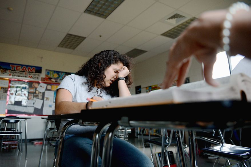Alicia Gonzalez, 14, works with her spelling coach and teacher Shelley Daisley, in Winchester, Va., in preparation for this week's Scripps National Spelling Bee.