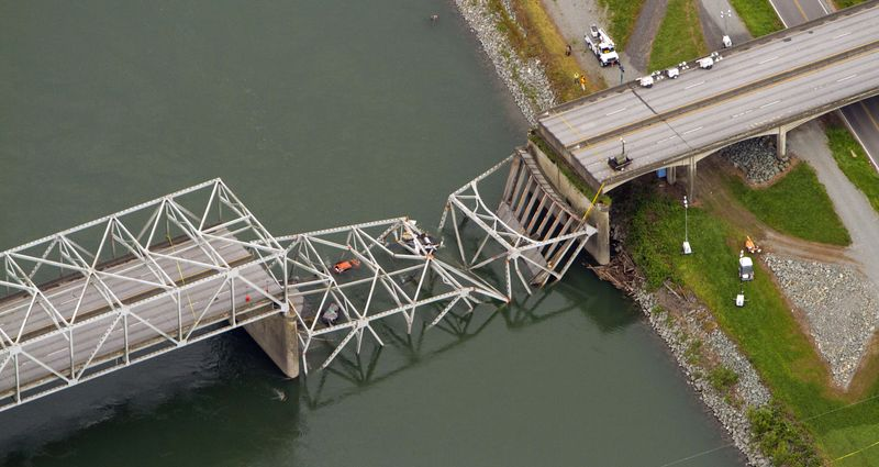 A collapsed section of the Interstate 5 bridge over the Skagit River is seen in an aerial view Friday, May 24, 2013. (AP Photo/The Seattle Times, Mike Siegel)