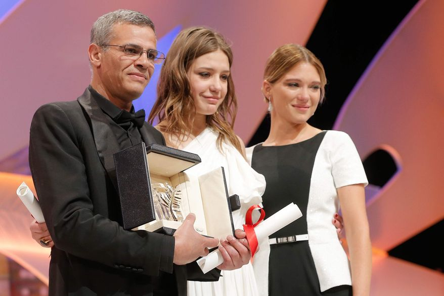 "From left, director Abdellatif Kechiche, actors Adele Exarchopoulos and Lea Seydoux react after they received the Palme d'Or award for the film ""La Vie D'Adele"" during an awards ceremony at the 66th international film festival, in Cannes, southern France, Sunday, May 26, 2013. (Photo by Todd Williamson/Invision/AP)"