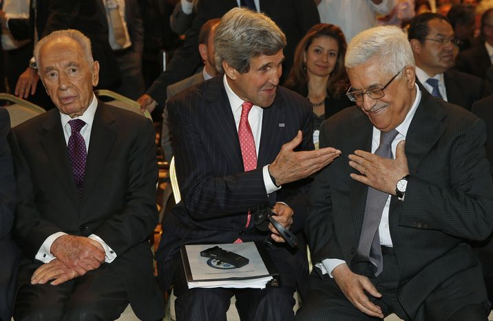 U.S. Secretary of State John Kerry speaks with Palestinian President Mahmoud Abbas, right, as he sits next to Israeli president Shimon Peres at the World Economic Forum on the Middle East and North Africa at the King Hussein Convention Centre, at the Dead Sea May 26, 2013. (AP Photo/Jim Young, Pool)