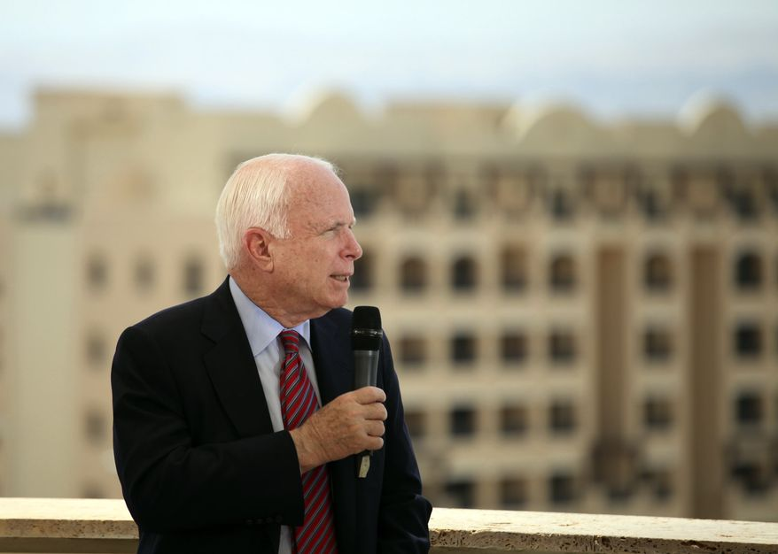 Republican Sen. John McCain during a TV interview, at the World Economic Forum, held at the King Hussein Bin Talal Convention center, in Southern Shuneh, 34 miles (55 kilometers) southeast of Amman, Jordan, Saturday, May 25, 2013.(AP Photo/Mohammad Hannon)