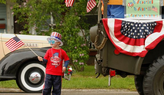 Jacob Webster, 4, of West Bend waits for the Memorial Day parade to begin in West Bend on Monday, May 27, 2013.  (AP Photo/The Daily News, John Ehlke)
