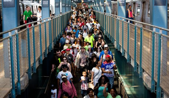 Dozens of beach-goers spill down an exit ramp on Memorial Day at Coney Island, Monday, May 27, 2013, in New York. Despite cool weather and cold water, thousands of visitors took to the sand and the boardwalk. (AP Photo/John Minchillo)