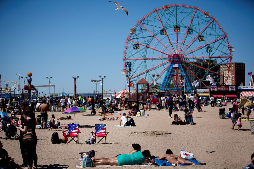 Two American flag-themed beach chairs rest on the sand on Memorial Day at Coney Island, Monday, May 27, 2013, in New York. Despite cool weather and cold water, thousands of visitors took to the sand and the boardwalk. (AP Photo/John Minchillo)