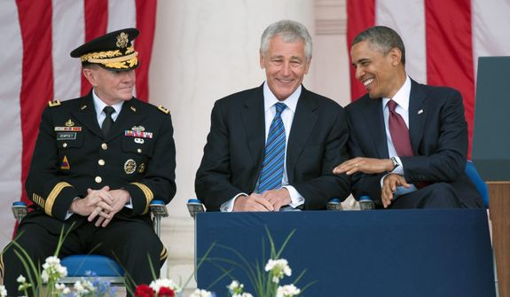 President Barack Obama talks with Secretary of Defense Chuck Hagel, center, as Chairman of the Joint Chiefs of Staff Gen. Martin Dempsey, left, looks on as they wait to deliver their Memorial Day remarks at Arlington National Cemetery in Arlington, Va., Monday, May 27, 2013. (AP Photo/Cliff Owen)