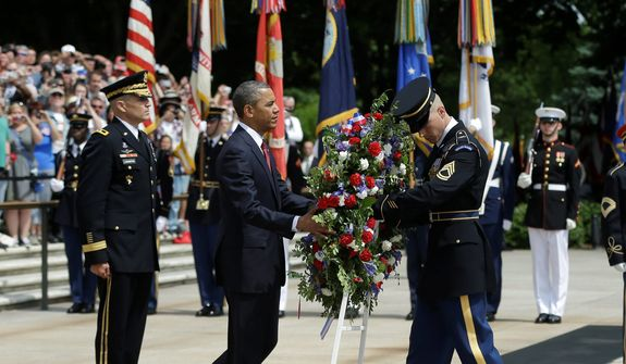 President Barack Obama, center, participates in the wreathlaying ceremony at the Tomb of the Unknowns with Maj. Gen. Michael S. Linnington, left, Commander of the U.S. Army Military District of Washington, at Arlington National Cemetery on Memorial Day, May 27, 2013, in Arlington, Va. (AP Photo/Pablo Martinez Monsivais)
