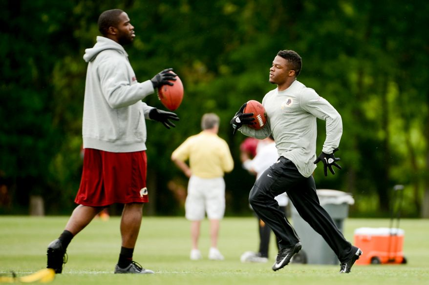 Washington Redskins wide receiver Pierre Garcon (88), left, and newly drafted running back Chris Thompson (35), right, works out during organized team activities at Redskins Park, Ashburn, Va., Thursday, May 23, 2013. (Andrew Harnik/The Washington Times)