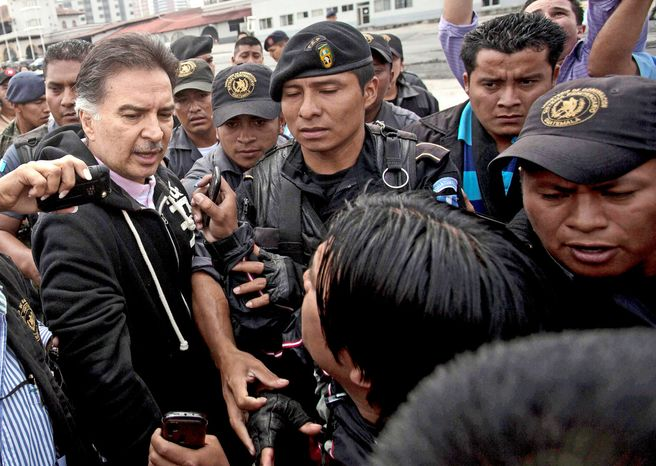 Former Guatemalan President Alfonso Portillo speaks to reporters in Guatemala City before boarding a flight to the U.S. Mr. Portillo was extradited to face charges of conspiring to launder millions of dollars embezzled from his government. He appeared before a U.S. district judge in New York on Tuesday. (Associated Press)