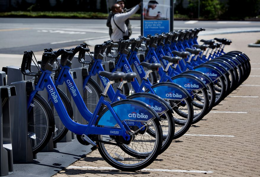 **FILE** Bicycles from the NYC Bike Share program are lined up at a dock-and-lock station at the Brooklyn Navy Yards in New York on May 12, 2013. The expanding bike share system allows those who join to ride bicycles and return them from the same or different docks in parts of New York. (Associated Press)