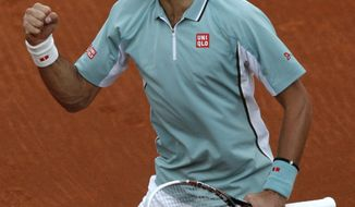 Serbia's Novak Djokovic reacts as he wins the second set while playing Belgium's David Goffin during their first round match of the French Open tennis tournament at the Roland Garros stadium Tuesday, May 28, 2013 in Paris. (AP Photo/Michel Spingler)