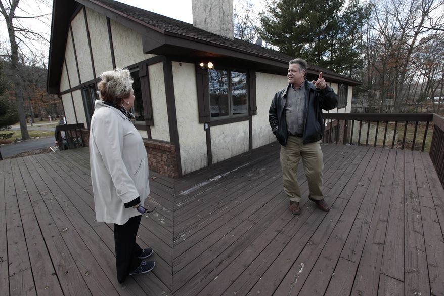 Sam and Liz Weidner of Hudsonville, Mich., view a home for sale in Cascade Township, Mich., on Tuesday, April 2, 2013. (AP Photo/Paul Sancya)