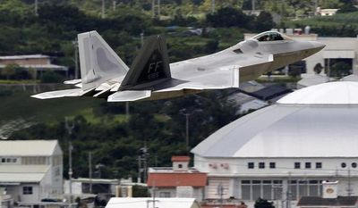 ** FILE ** In this Aug. 14, 2012, file photo, a U.S. Air Force F-22 Raptor stealth fighter takes off from Kadena Air Base on the southern island of Okinawa in Japan. (AP Photo/Greg Baker, File)