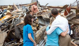 President Barack Obama hugs Amy Simpson, principal of Plaza Towers Elementary School, outside what remains of the school following last week's tornado in Moore, Okla., May 26, 2013. (Official White House Photo by Pete Souza)