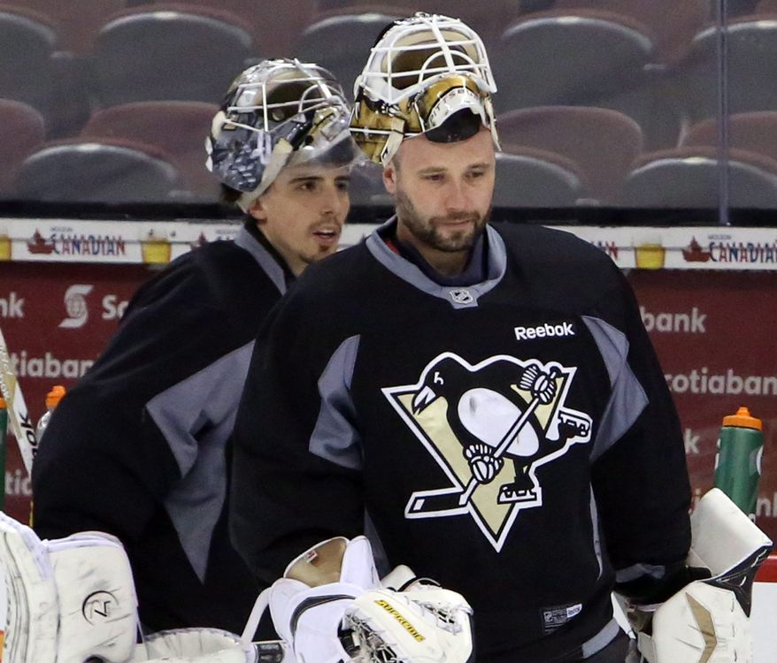 Pittsburgh Penguins goaltenders Marc-Andre Fleury,left, and Tomas Vokoun practice in Ottawa, Ontario, Saturday, May 18, 2013, on the eve of Game 3 of the NHL hockey Stanley Cup playoff series against the Ottawa Senators. (AP Photo/The Canadian Press, Fred Chartrand)