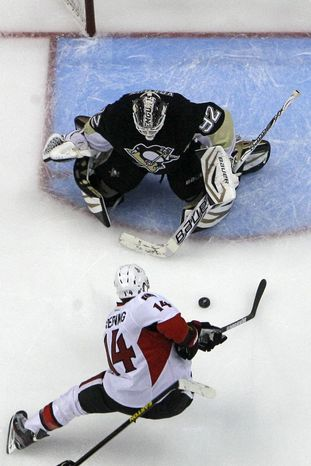 Pittsburgh Penguins goalie Tomas Vokoun (92) stops a break away shot by Ottawa Senators' Colin Greening (14) in the second period of Game 2 of an NHL hockey Stanley Cup second-round playoff series, in Pittsburgh on Friday, May 17, 2013. The Penguins won 4-3. (AP Photo/Gene J. Puskar)