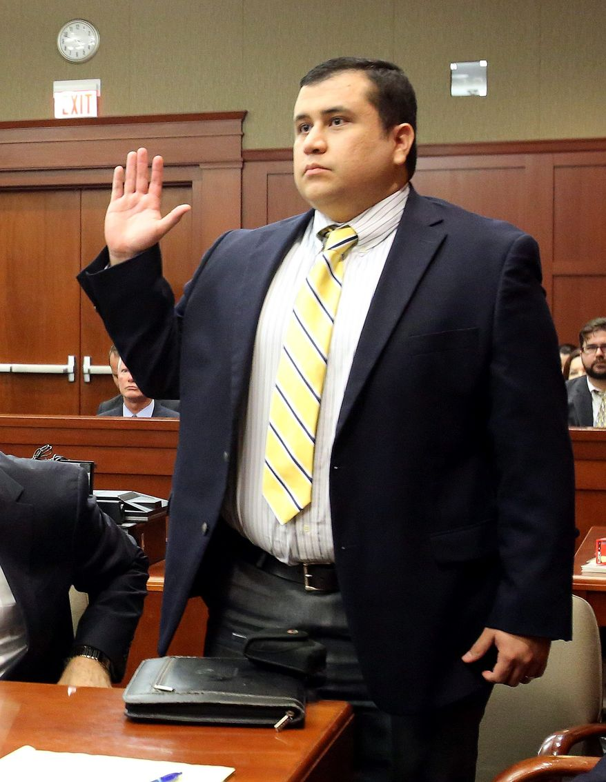 ** FILE ** Defendant George Zimmerman, accused in the killing of Trayvon Martin, is sworn in for testimony in Seminole circuit court, in Sanford, Fla., during a pre-trial hearing, Tuesday, April 30, 2013. (AP Photo/Orlando Sentinel, Joe Burbank, Pool)