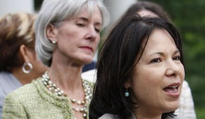 **FILE** Nancy-Ann DeParle (right), director of the White House Office of Health Reform, accompanied by Health and Human Services Secretary Kathleen Sebelius (left) and various state legislators, speaks outside the West Wing of the White House in Washington on June 17, 2009. (Associated Press)