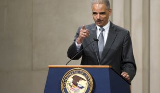 Attorney General Eric Holder acknowledges award recipients as he speaks during the Office of Inspector Generals annual awards ceremony on May 29, 2013, at the Justice Department in Washington. (Associated Press)