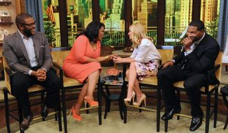 "This image released by Disney-ABC Domestic Television shows actor-director-producer Tyler Perry (left) with Oprah Winfrey and co-hosts Kelly Ripa (second right) and Michael Strahan (right) on ""Live with Kelly and Michael,"" on May 28, 2013 in New York. (Associated Press/Disney-ABC Domestic Television)"