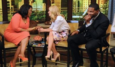 """This image released by Disney-ABC Domestic Television shows actor-director-producer Tyler Perry (left) with Oprah Winfrey and co-hosts Kelly Ripa (second right) and Michael Strahan (right) on """"Live with Kelly and Michael,"""" on May 28, 2013 in New York. (Associated Press/Disney-ABC Domestic Television)"""