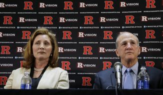 ** FILE ** In this May 15, 2013, file photo, Julie Hermann, left, sits with Rutgers president Roberet L. Barchi, as they listen to a question during a news conference where she was introduced as the new athletic director at Rutgers University in Piscataway, N.J. (AP Photo/Mel Evans, File)
