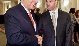 ** FILE ** Virginia gubernatorial candidates Terry McAuliffe (left), a Democrat, and Kenneth T. Cuccinelli II, a Republican, meet before a luncheon sponsored by the Virginia Public Access Project in Richmond on Thursday, May 30, 2013. (The Richmond Times-Dispatch via Associated Press)