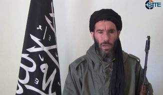 Terrorist leader Moktar Belmoktar purportedly is shown in an image taken from video provided by the SITE Intel Group and made available on Thursday, Jan. 17, 2013. (AP Photo/SITE Intel Group)