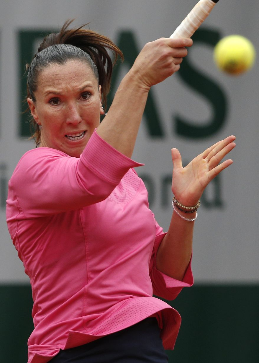 Serbia's Jelena Jankovic returns the ball to Spain's Garbine Muguruza during their second round match of the French Open tennis tournament at the Roland Garros stadium Thursday, May 30, 2013 in Paris. (AP Photo/Michel Spingler)