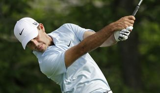 Charl Schwartzel, of South Africa, tees off the fourth hole during the first round of the Memorial golf tournament Thursday, May 30, 2013, in Dublin, Ohio. (AP Photo/Darron Cummings)
