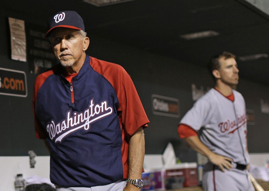 The Washington Nationals fell to .500 Thursday night after a 2-0 loss to the Baltimore Orioles. Davey Johnson, left, and Adam LaRoche, right, look on during the game. (Associated Press photo)
