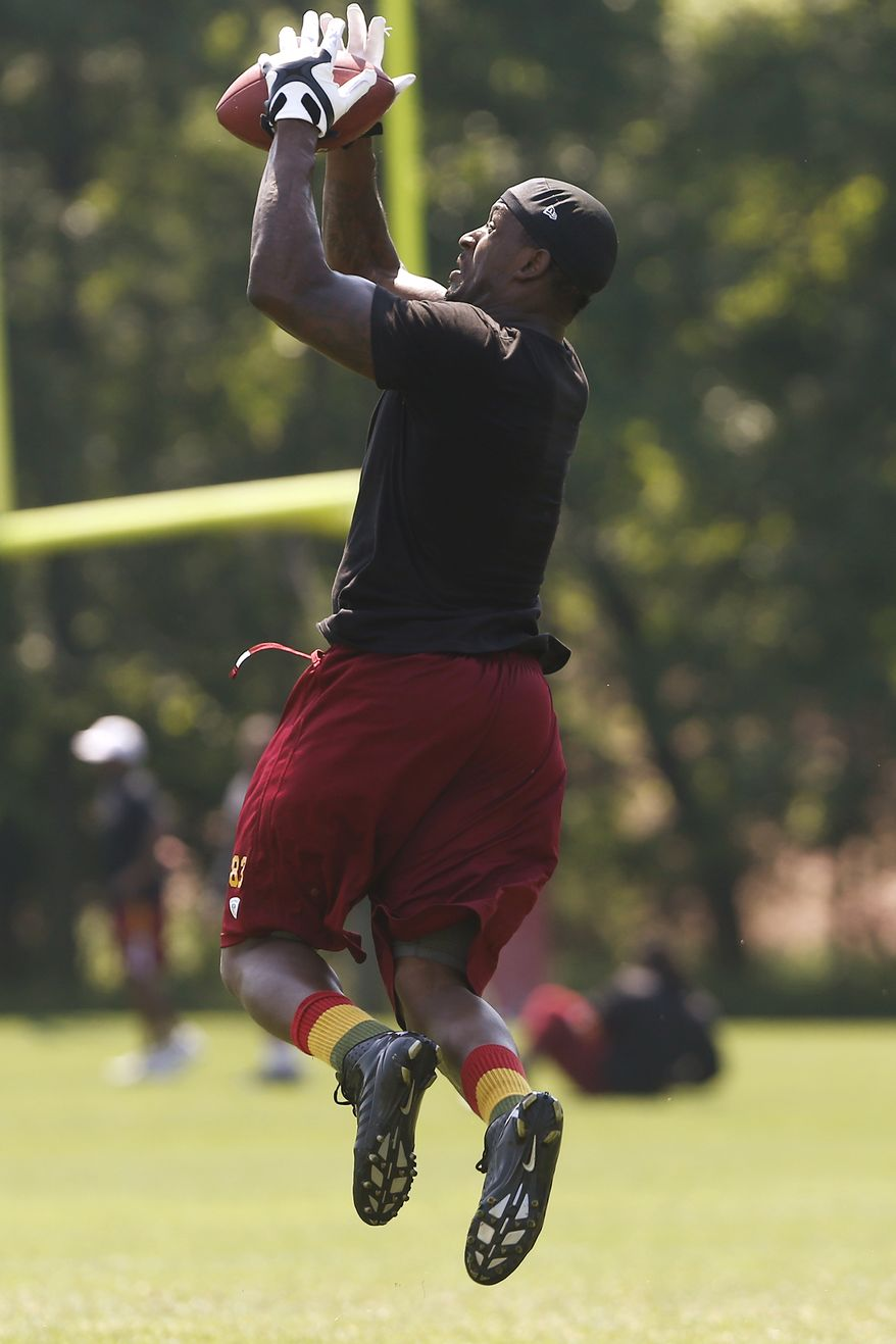 Washington Redskins tight end Fred Davis (83) practices during an NFL football organized team activity at Redskins Park in Ashburn, Va., Thursday, May 30, 2013. (AP Photo/Charles Dharapak)